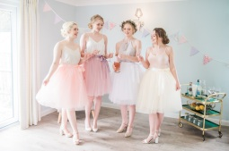Pastel bridal shower styling provided by www.pitch-boutique.co.uk - featuring colourful gin bottles, springtime flowers, tulle skirts, floral cupcakes and confetti cannons!