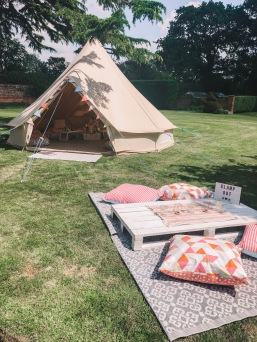Electric COACHELLA inspired glamping party provided by www.pitch-boutique.co.uk - our beautiful bell tents are styled with festival brights colours and festival decorations for a dreamy bell tent interior!